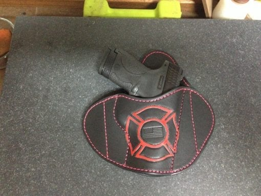 OWB Holster (Red/Black with Handgun on Table)